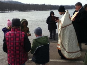 Father Michael Demko blessing the waters